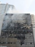 Firefighters Tackle a Blaze in an Office Block Stock Photos