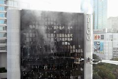 Firefighters Tackle a Blaze in an Office Block Royalty Free Stock Image