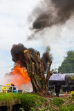 Firefighters train near the stump. Stock Photography