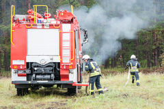 Firefighters trained to extinguish a burning forest Stock Photo