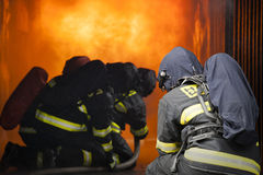 Firefighters. Training - firefighters in burning shipping container Stock Photo