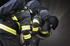 Firefighters. Training - firefighters in burning shipping container Royalty Free Stock Photography