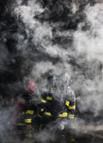 Firefighters. Training - firefighters in burning shipping container Royalty Free Stock Photo