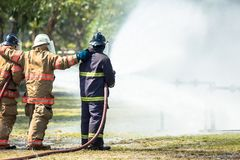 Firefighters are training for fighting. royalty free stock photos