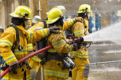 Firefighters training, foreground is drop of water springer, Selective focus stock images