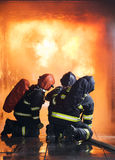 Firefighters. Training inside burning shipping container Stock Photography