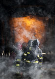 Firefighters. Training inside burning shipping container Royalty Free Stock Images