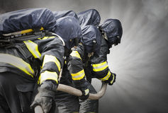 Firefighters. Training inside burning shipping container - attack Royalty Free Stock Images