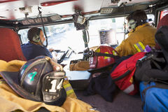 Firefighters travelling to an emergency.  Royalty Free Stock Image