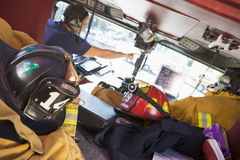 Firefighters travelling to an emergency.  Stock Image
