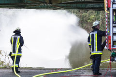Firefighters in Uniform during training. ESSEN KETTWIG, NRW, GERMANY - APRIL 28, 2016 Royalty Free Stock Photos