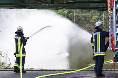 Firefighters in Uniform during training. Essen Kettwig, Nrw, Germany - April 28, 2016 Stock Images