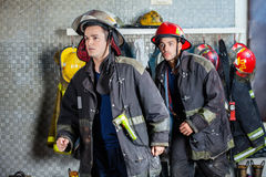 Firefighters In Uniforms Walking At Fire Station Royalty Free Stock Photos