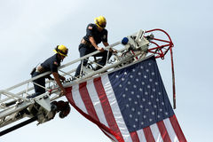 Firefighters with USA flag royalty free stock image