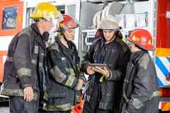 Firefighters Using Tablet Computer At Fire Station Royalty Free Stock Photography