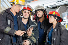 Firefighters Using Tablet Computer Royalty Free Stock Photography