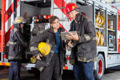 Firefighters Using Tablet Computer Stock Image