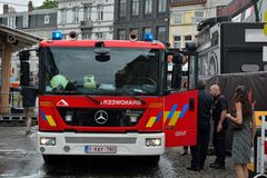 Firefighters at work in the early morning at the Ghent  Festival, Belgium Stock Photography