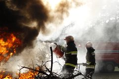 Firefighters at work in the smoke royalty free stock images