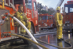 Firefighters working at apartment fire, Los Angeles, California Stock Photo