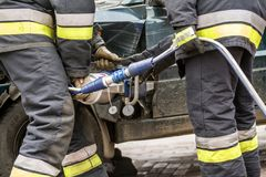 Firefighters working on an auto vehicle extrication royalty free stock images
