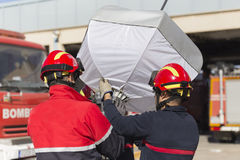 Firefighters working with auxiliary lighting Royalty Free Stock Image