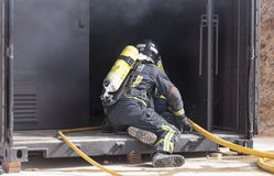 Firefighters working Stock Photos