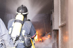 Firefighters working Stock Images
