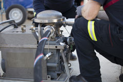 Firefighters working with a suction pump Royalty Free Stock Photo