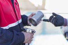 Firefighters working with a suction pump Royalty Free Stock Image