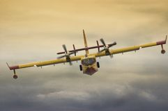 Firefighting aircraft flying low during exhibition. Firefighting aircraft flying low during an aerial exhibition, flying directly to the spectators stock photography