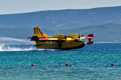 Firefighting aircraft landing for pick up water Stock Image