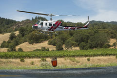 Firefighting California helicopter with water bucket Stock Photography