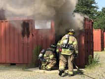 Firefighters prepare to enter training scenario Royalty Free Stock Images