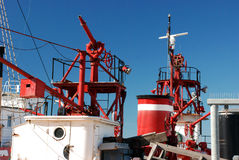 Firefighting equipment. Antique fire boat equipment against blue sky Stock Photography