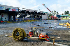 Firefighting equipment. Kent, WA, USA November 14, 2016: Fireman operates water nozzle on extension boom of fire engine at scene of fire at Dollar Tree store in Royalty Free Stock Photos