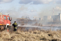 Firefighting on the field Royalty Free Stock Images