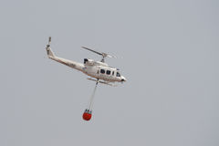 Firefighting Helicopter. In the Empty Summer Sky Over Valencia Province in Spain Stock Photo