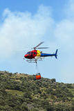 Firefighting helicopter - Transport. Firefighting helicopter carrying water to extinguish the fire Stock Image