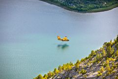 Firefighting plane in the air. Firefighting plane training in Krka park, Croatia royalty free stock image