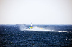 Firefighting plane and boats Royalty Free Stock Photos