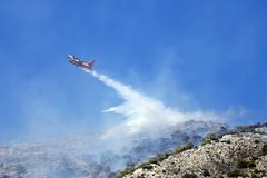 Firefighting plane extinguishes a fire on the hillside . Greece. Firefighting plane extinguishes a fire on the hillside stock photography