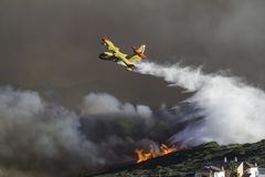 Firefighting plane. Dousing flames with water in southern Spain stock images