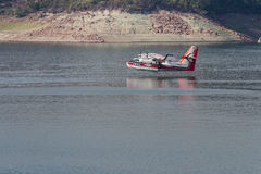 Firefighting plane. Lost Creek Lake, Oregon  - September 7 : Supperscooper plane after scoping water out of Lost Creek Lake to fight the 790 Fire, September 7 Royalty Free Stock Images