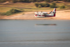 Firefighting plane. Lost Creek Lake, Oregon  - September 7 : Supperscooper plane after scoping water out of Lost Creek Lake to fight the 790 Fire, September 7 Stock Photos