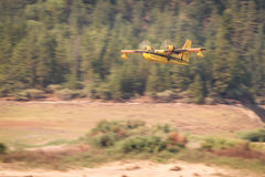 Firefighting plane. Lost Creek Lake, Oregon  - September 7 : Supperscooper plane after scoping water out of Lost Creek Lake to fight the 790 Fire, September 7 Stock Images