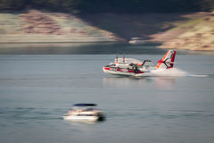 Firefighting plane. Lost Creek Lake, Oregon  - September 7 : Supperscooper plane scoping water out of Lost Creek Lake to fight the 790 fire, September 7 2014 in Stock Images