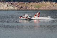 Firefighting plane. Lost Creek Lake, Oregon  - September 7 : Supperscooper plane scoping water out of Lost Creek Lake to fight the 790 fire, September 7 2014 in Stock Photography