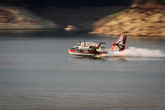 Firefighting plane. Lost Creek Lake, Oregon  - September 7 : Supperscooper plane scoping water out of Lost Creek Lake to fight the 790 fire, September 7 2014 in Royalty Free Stock Photography