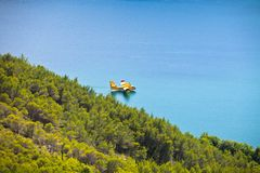 Firefighting plane in the air. Firefighting plane training in Krka park, Croatia stock photo